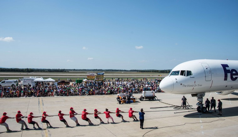 People pull an airplane during the Dulles Day Plane pull at Dulles airport in Virginia, outside Washington. The event is a fundraiser for Special Olympics Virginia, which provides sports training and athletic competition in a variety of Olympic-type sports for children and adults with intellectual disabilities. (Nicholas Kamm/AFP-Getty Images)