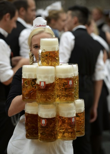 A waitress carries mugs of beer in the Schottenhamel tent during the opening day of the 181st Oktoberfest in Munich. Millions of beer drinkers from around the world will come to the Bavarian capital over the next two weeks for the Oktoberfest, which starts today and runs until October 5. (Lukas Barth/reuters)