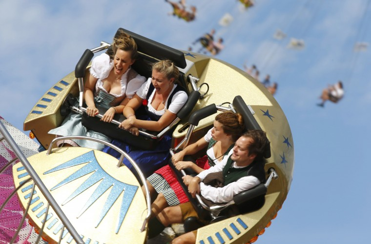 Visitors enjoy a firground ride during the opening day of the 181st Oktoberfest in Munich. Millions of beer drinkers from around the world will come to the Bavarian capital over the next two weeks for the Oktoberfest, which starts today and runs until October 5. (Michael Dalder/Reuters)