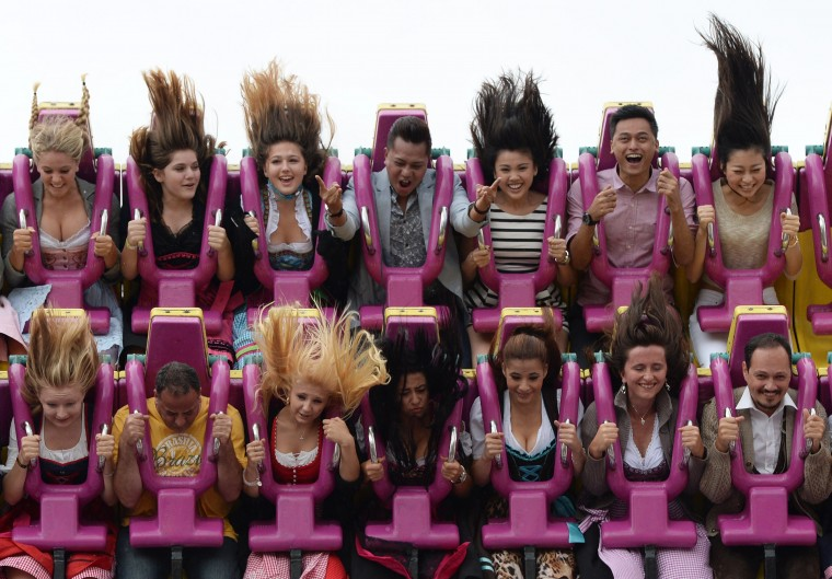 Visitors enjoy a fun ride on the opening day of the traditional Bavarian Oktoberfest festival at the Theresienwiese fair grounds in Munich, southern Germany. Germany's world-famous Oktoberfest kicks off with millions of revellers set to soak up the frothy atmosphere in a 16-day extravaganza of lederhosen, oompah music and, of course, beer. (Christof Stache/AFP-Getty Images)