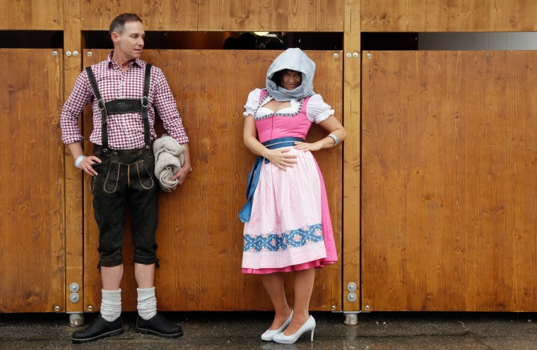 Revellers wait to enter a beer tent during the opening day of the 2014 Oktoberfest in Munich, Germany. The 181st Oktoberfest will be open to the public from September 20 through October 5 and traditionally draws millions of visitors from across the globe to the the world's largest beer festival. (Johannes Simon/Getty Images)