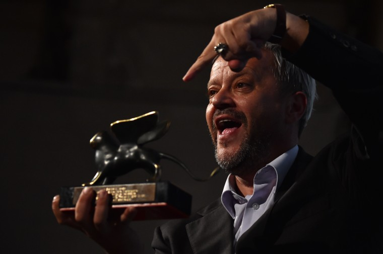 Emir Hadzihafizbegovic poses with the Special Orizzonti Award for best actor he received for his role in 'These Are The Rules' during a photocall following the awards ceremony on the closing day of the 71st Venice Film Festival at Venice Lido. (Gabriel Bouys/AFP-Getty Images)