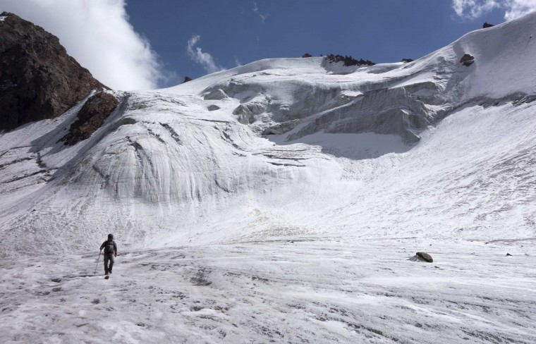 A tourist walks across the Manshuk Mametova glacier, about 3,550 metres (11,647 feet) above sea level, in the mountains of Tien Shan outside Almaty. (Shamil Zhumatov/Reuters)