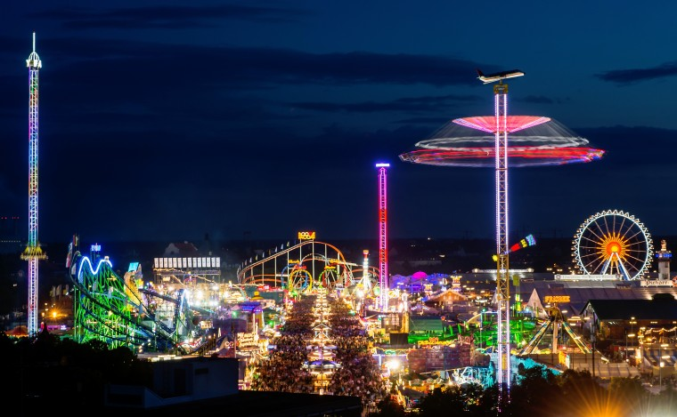 The colourful lights of the Oktoberfest begin to shine during sunset at the opening day of the 2014 Oktoberfest in Munich, Germany. Oktoberfest is the world's biggest beer bash and draws millions of visitors. The annual event lasts for three weeks and will open its doors on September 20. (Joerg Koch/Getty Images)