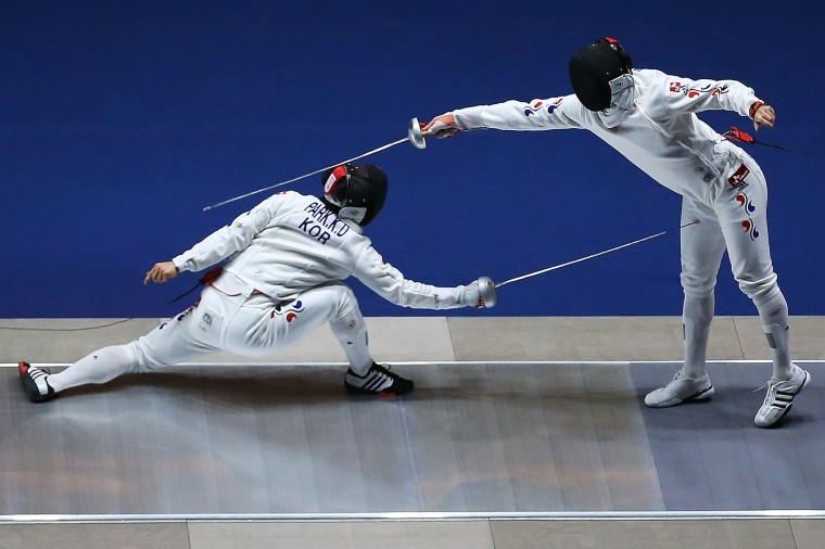 Jung Jinsun and Park Kyoungdoo of South Korea compete in the Men's Epee Final during day one of the 2014 Asian Games at Goyang Gymn(Brendon Thorne/Getty Images)