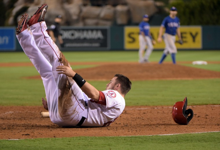 Los Angeles Angels first baseman C.J. Cron reacts after being thrown out at home plate while trying to score in the seventh inning against the Texas Rangers at Angel Stadium of Anaheim. The Rangers defeated the Angels 12-3. (Kirby Lee/USA Today Sports)