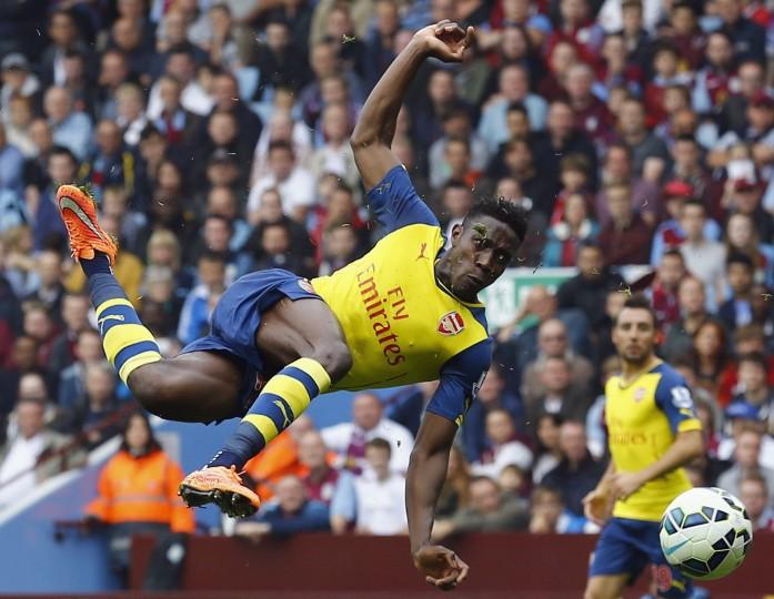Arsenal's Danny Welbeck shoots at goal during their English Premier League soccer match against Aston Villa at Villa Park in Birmingham, central England. (Darren Staples/Reuters)