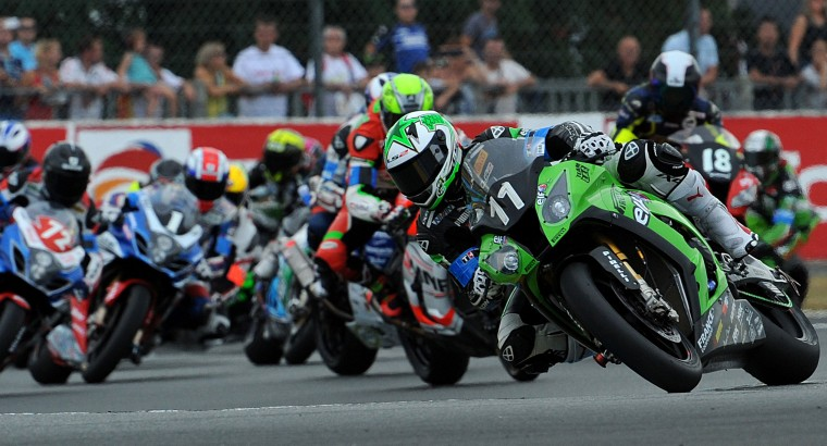 France's Gregory Leblanc rides his Kawasaki No. 11 (R) as he competes ahead of the pack during the 37th Le Mans 24 hours endurance race in Le Mans, western France. (Guillame Souvant/AFP-Getty Images)