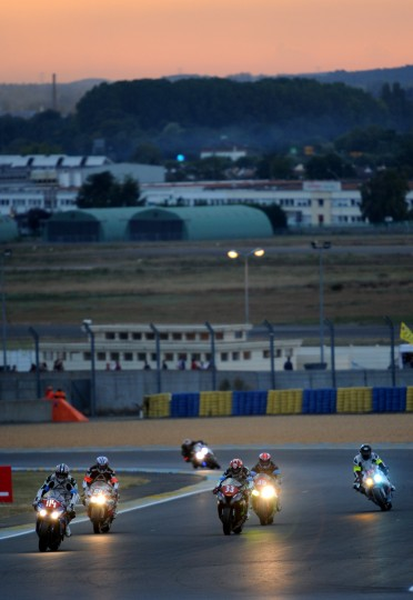 Riders compete as the sun sets during the 37th Le Mans 24 hours moto endurance race on in Le Mans, western France. (Guillame Souvant/AFP-Getty Images)