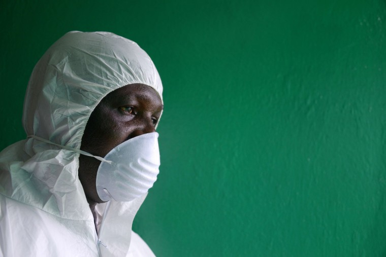 A health worker, wearing a protective suit, conducts an ebola prevention drill at the port in Monrovia on August 29, 2014. The World Health Organization said yesterday that the number of Ebola cases was increasing rapidly and could exceed 20,000 before the virus is brought under control, as the death toll topped 1,500. (Dominique Faget/AFP/Getty Images )