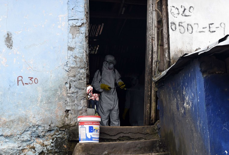 A medical staff member of the Croix Rouge NGO disinfects inside a house after collecting the corpse of a victim of Ebola, in Monrovia, on September 29, 2014. Of the four west African nations affected by the Ebola outbreak, Liberia has been hit the hardest, with 3,458 people infected -- more than half of the total number of cases. Of those, 1,830 have died, according to a WHO count released on September 27. (Pascal Guyot/AFP/Getty Images)