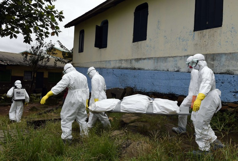Medical staff members of the Croix Rouge NGO carry on a stretcher the corpse of a victim of Ebola, after collecting it from a house in Monrovia, on September 29, 2014. Of the four west African nations affected by the Ebola outbreak, Liberia has been hit the hardest, with 3,458 people infected -- more than half of the total number of cases. Of those, 1,830 have died, according to a WHO count released on September 27. (Pascal Guyot/AFP/Getty Images)
