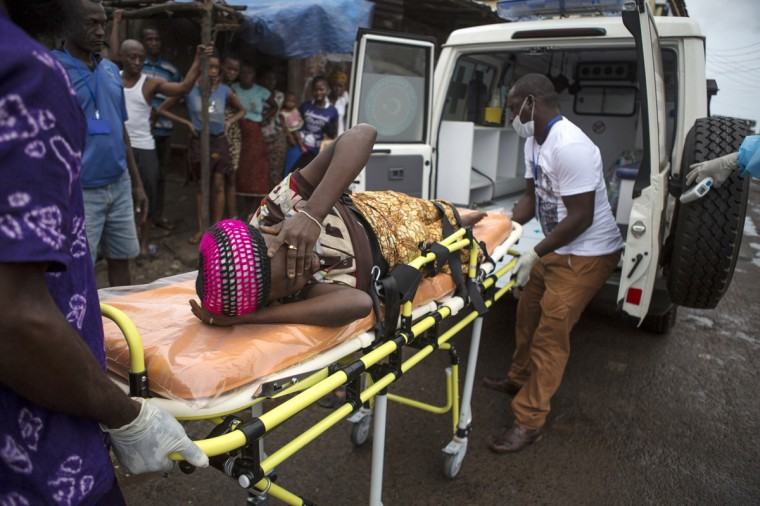 """A pregnant woman suspected of contracting Ebola is lifted by stretcher into an ambulance in Freetown, Sierra Leone September 19, 2014 in a handout photo provided by UNICEF. Sierra Leone's army has """"sealed off"""" the borders with Liberia and Guinea in a bid to halt the spread of Ebola, the army spokesman said on September 23, 2014. The spokesman told Reuters that troops had been sent to all border crossing points. (Bindra/UNICEF/Reuters)"""