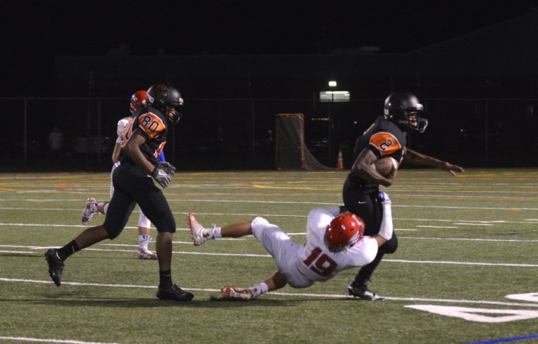 Oakland Mills' David Pindell is caught by Centennial's Mason Smith in Friday night's game. (Nicole Munchel/BSMG)