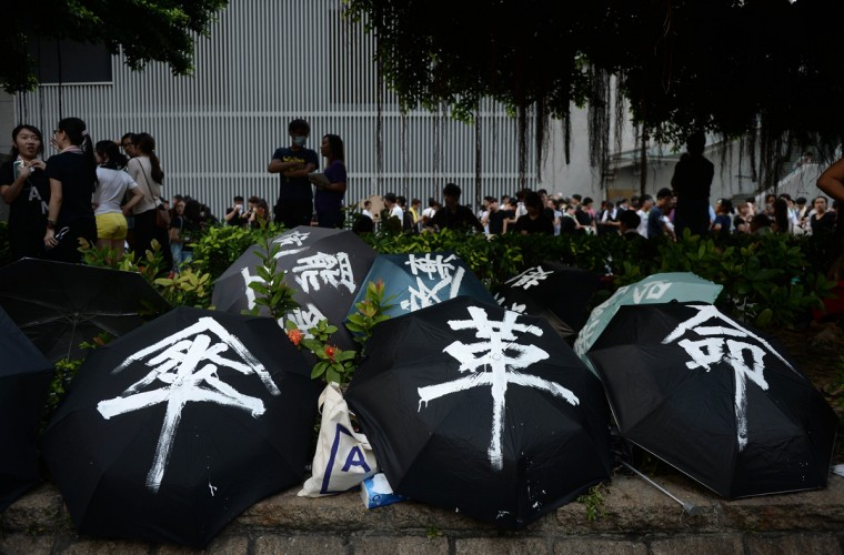 Umbrellas used to shield demonstrators from pepper spray and the sun are displayed during a pro-democracy protest near the Hong Kong government headquarters on September 29, 2014. Police repeatedly fired tear gas after tens of thousands of pro-democracy demonstrators brought parts of central Hong Kong to a standstill on September 28 in protest at Beijing's refusal to grant the city unfettered democracy. Dale De La Rey/AFP/Getty Images)