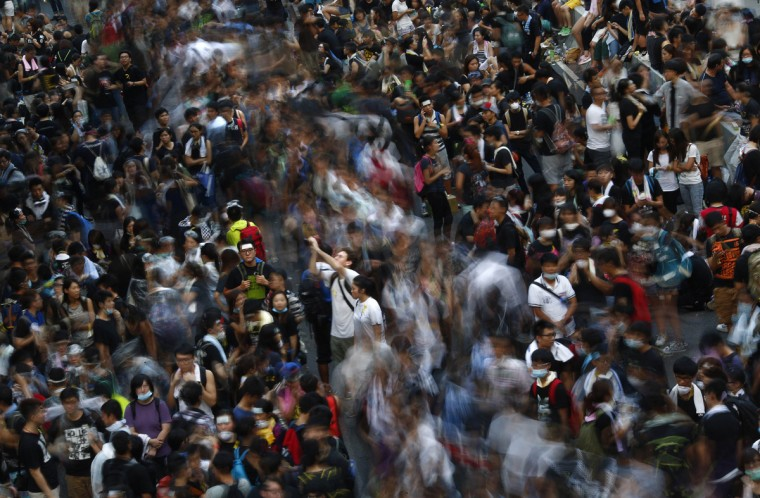 Protesters block the main street to the financial Central district, outside the government headquarters in Hong Kong, September 29, 2014. Hong Kong democracy protesters defied volleys of tear gas and police baton charges to stand firm in the centre of the global financial hub on Monday, one of the biggest political challenges for Beijing since the Tiananmen Square crackdown 25 years ago. China wagged its finger at the student protesters, and warned against any foreign interference as they massed again in business and tourist districts of the city in the late afternoon. (Carlos Barria/Reuters)