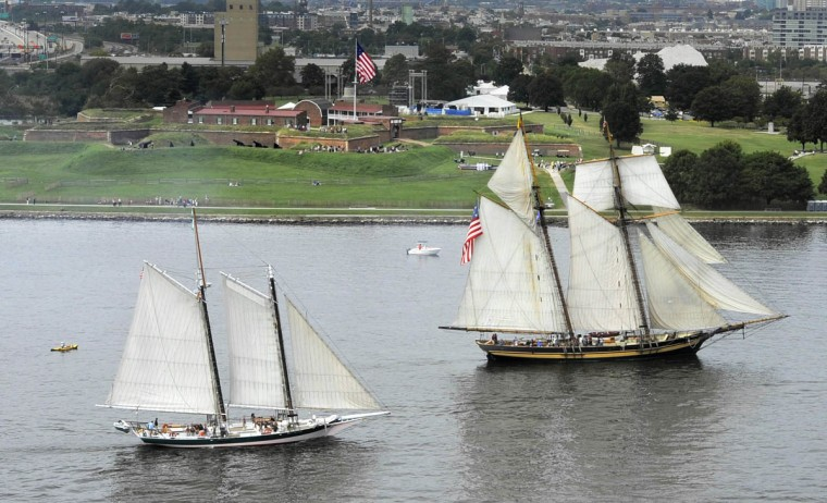 Lady Maryland (left) and The Pride of Baltimore II take part in the Star-Spangled Banner Bicentennial Celebration as it sails past Fort McHenry. Pride of Baltimore II is a reproduction of an 1812-era topsail schooner privateer. Lady Maryland is a replica pungy schooner.