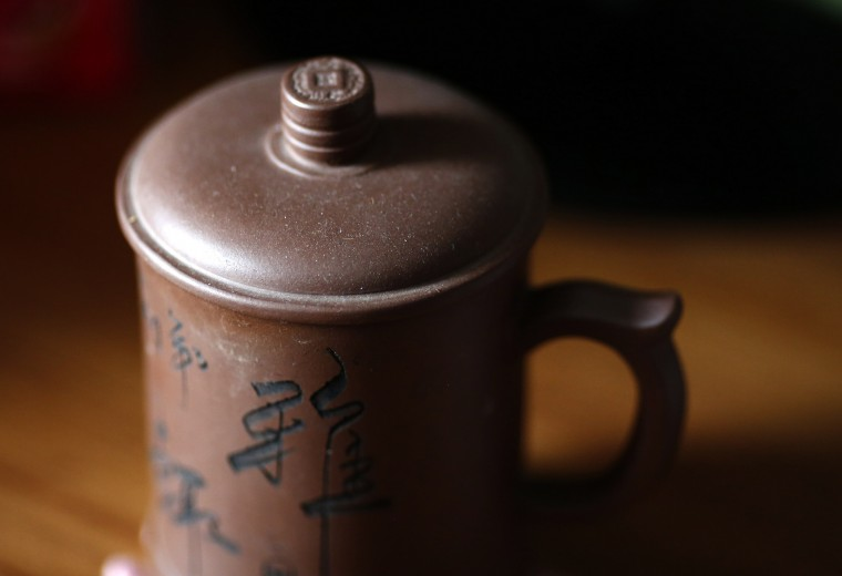 A tea cup of Li Zhijin, who was onboard Malaysia Airlines Flight MH370 which disappeared on March 8, 2014 is covered with dust on his desk at his house in Beijing July 22, 2014. Li's wife Liu said she argued with her husband in their last phone call before the incident. She could not have realised that this would be their last conversation and now that is her greatest regret. (Kim Kyung-Hoon/Reuters)
