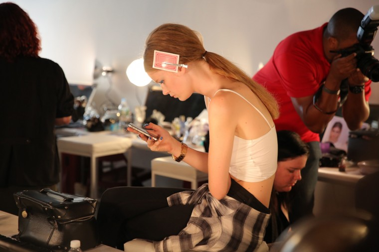 A model prepares backstage before the HONOR fashion show at Art Beam on September 4, 2014 in New York City. (Photo by Chelsea Lauren/Getty Images)