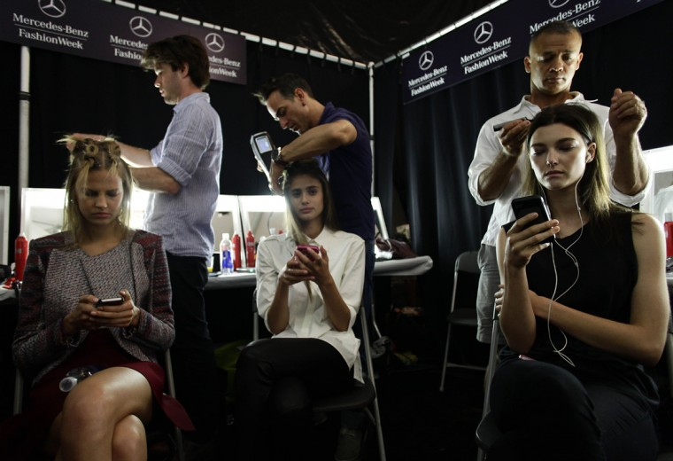 Models have their hair styled backstage before presenting creations by BCBG Max Azria Spring/Summer 2015 collection during New York Fashion Week, September 4, 2014 in New York. (Joshua Lott/AFP/Getty Images)