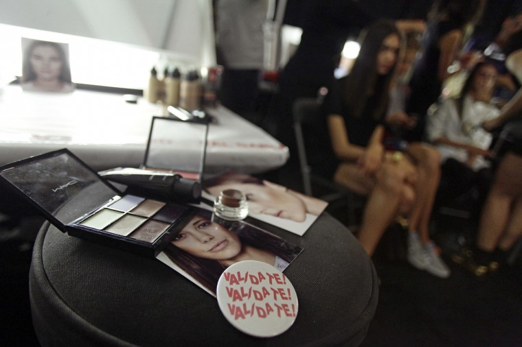 Model cards and make-up rest on a stool backstage before the BCBG Max Azria Spring/Summer 2015 collection, during New York Fashion Week September 4, 2014 in New York. (Joshua Lott/AFP/Getty Images)