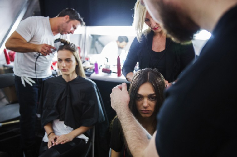 Models have their hair done backstage before presenting the BCBG Max Azria collection during New York Fashion Week September 4, 2014.The 2014 New York Fashion Week goes from September 4-11. (Lucas Jackson/Reuters)