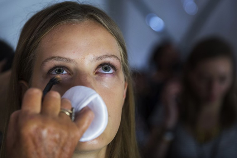 A model has make up applied backstage before showing the BCBG Max Azria collection during New York Fashion Week September 4, 2014. (Lucas Jackson/Reuters)