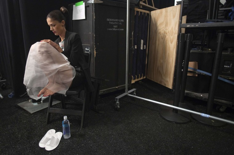 A model sits and waits backstage before the Carolina Herrera Spring/Summer 2015 collection show during New York Fashion Week in the Manhattan borough of New York September 8, 2014. (Carlo Allegri/Reuters)