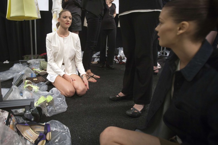 Models talk as they wait backstage before the Carolina Herrera Spring/Summer 2015 collection show during New York Fashion Week in the Manhattan borough of New York September 8, 2014. (Carlo Allegri/Reuters)