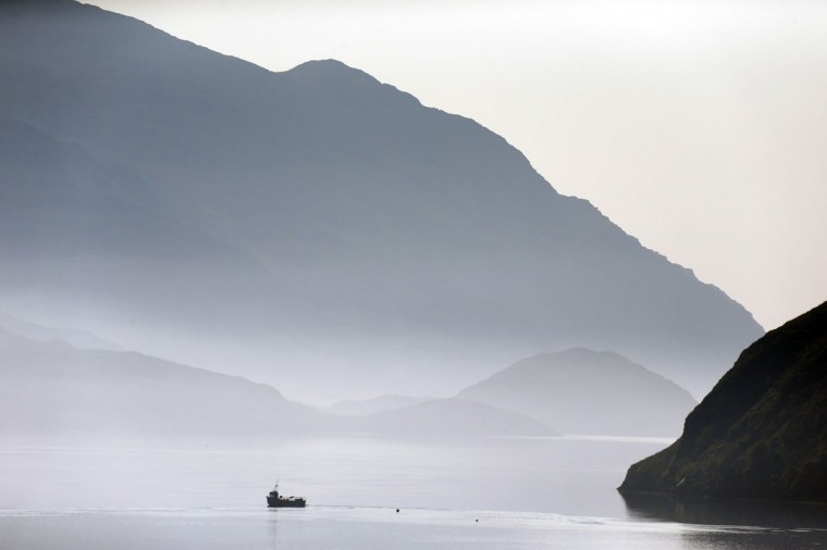 A fishing boat sails along the shore on the Isle of Lewis, in the Outer Hebrides of Scotland on September 15, 2014. (REUTERS/Cathal McNaughton)