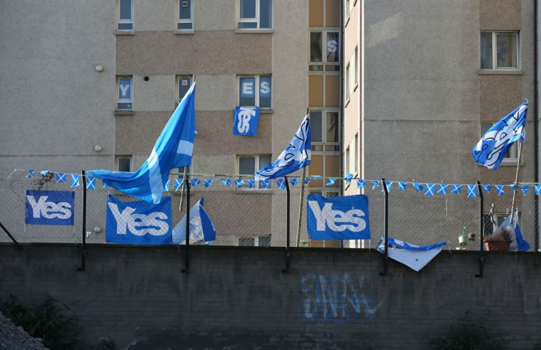 'YES' campaign flags fly from a fence near a tower block in Edinburgh on September 10, 2014. (REUTERS/Paul Hackett)