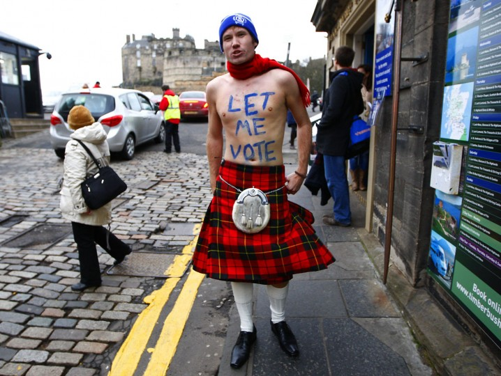 James Wallace wears a kilt as he stands outside the entrance to Edinburgh castle in Scotland on January 25, 2012. (REUTERS/David Moir)
