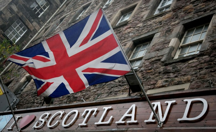 The Union Flag flies above a gift shop in central Edinburgh on September 19, 2014. The majority of Scottish people voted 'No' in the referendum and Scotland will remain within the historic union of countries that make up the United Kingdom. (Photo by Matt Cardy/Getty Images)