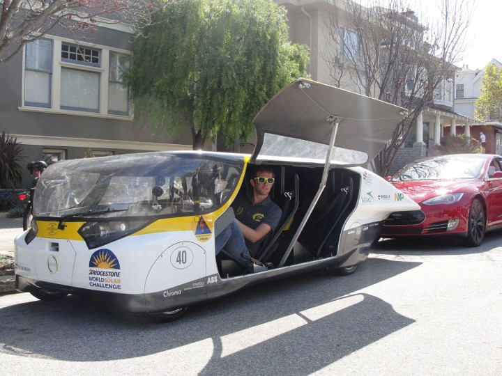 "Andre Snoeck, operations manager for Solar Team Eindhoven prepares to drive off in solar-powered family car 'Stella' in San Francisco. A solar-powered family car completed its drive from Los Angeles to San Francisco fueled by good vibes and pure California sunshine. And after turning the heads of gobsmacked onlookers during its journey up California's scenic Pacific Coast Highway, the creators of ""Stella"" are dreaming of a day when their futuristic vehicle is a commonplace sight. The lightweight, wedge-shaped automobile is capable of traveling 500 miles (800km) on a single charge -- further if the sun is shining -- while clocking 80 miles per hour. (Glenn Chapman/Getty Images)"
