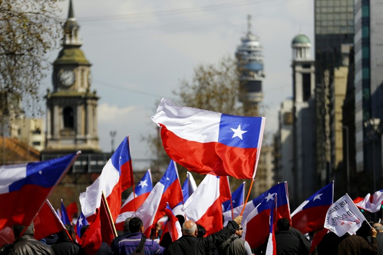 Protesters wave Chilean flags as they march during a demonstration in downtown Santiago, September 4, 2014. Chilean workers marched through the streets as they demanding for labour reform projects. (Ivan Alvarado/Reuters)
