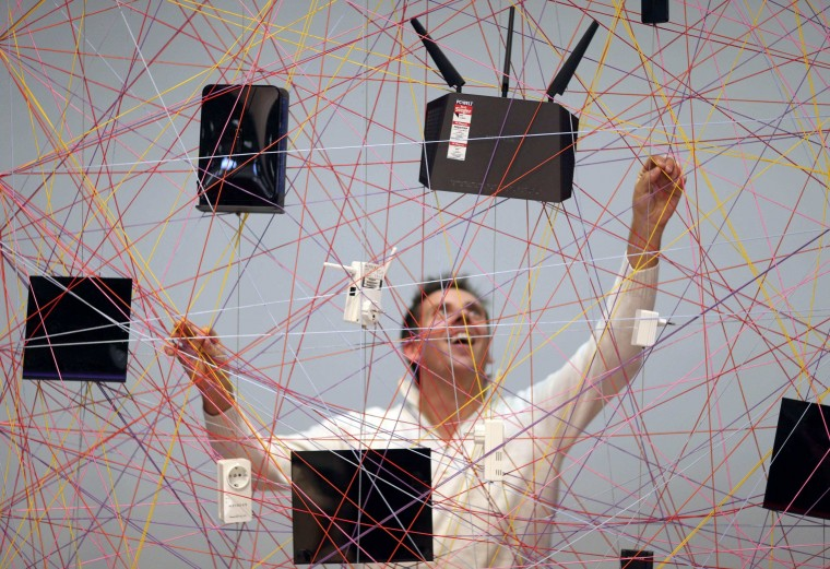 Devices produced by U.S. manufacturer of computer networking equipment Netgear are displayed on a web during the IFA Electronics show in Berlin September 4, 2014. (Hannibal Hanschke/Reuters)