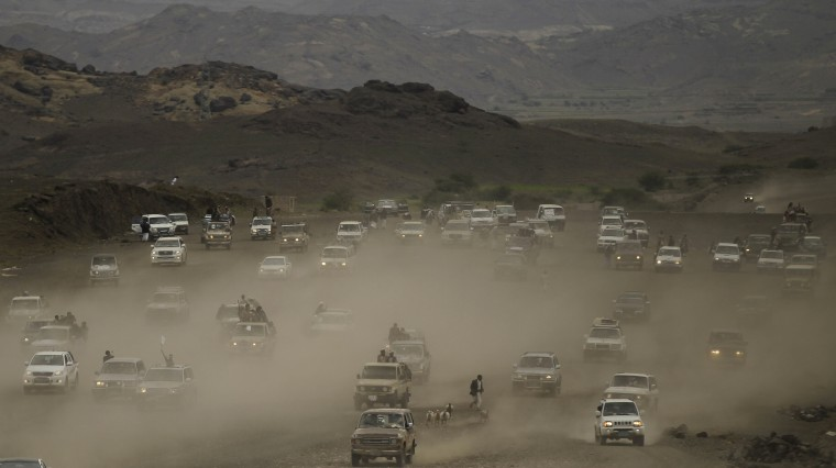 Vehicles carrying followers of the Shi'ite Houthi movement drive on a road leading to the movement's camp in southern Sanaa September 4, 2014. Yemen will partially restore a fuel subsidy from Thursday in an attempt to calm anti-government protests in the capital that have threatened to destabilize the impoverished Arab state, according to the cabinet. The plan to ease petrol prices by about 30 percent has however failed to mollify the Shi'ite Houthi rebel group, which also rejected a proposal - still on the table - by president Abed Rabbu Mansour Hadi on Wednesday to form a unity government. (Khaled Abdullah/Reuters)