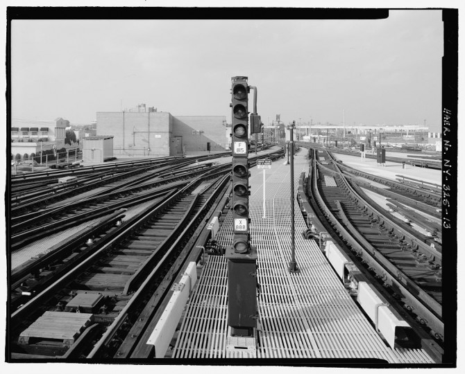 View from center platform toward signal department building along tracks, looking north. Stillwell Avenue Station, Intersection of Stillwell & Surf Avenues, Brooklyn, Kings County, NY. (Library of Congress)