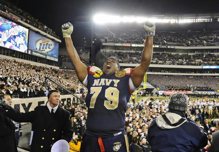 Navy's Osei Asante cheers after leading the band in the playing of the Naval Academy Alma Mater after the Mids' win over Army in Philadelphia in December 2009,. (Kenneth K. Lam/Baltimore Sun)