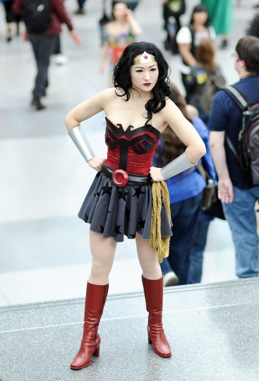 A Comic Con attendee poses as Wonder Woman during the 2014 New York Comic Con at Jacob Javitz Center. Daniel Zuchnik/Getty Images