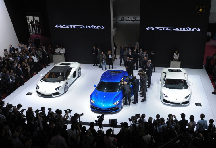 Visitors look at Lamborghini Asterion cars at the Lamborghini stand at the Paris Auto Show on October 2, 2014 on the first of the two press days. Eric Piermont/AFP/Getty Images