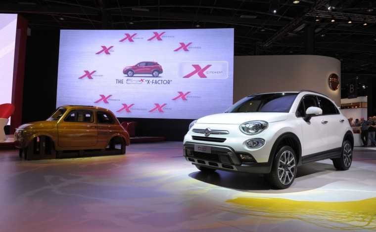 The Fiat 500 X is unveiled at the Paris Auto Show in front of the Fiat 500 wooden prototype on October 2, 2014 on the first of the two press days. Eric Piermont/AFP/Getty Images