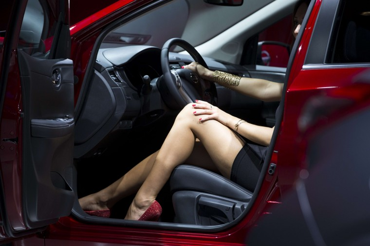 A model poses in a car at the stand of Japanese carmaker Nissan at the Paris Auto Show in Paris on October 2, 2014. Joel Saget/AFP/Getty Images
