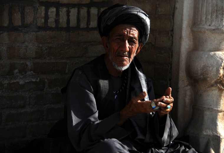 "An Afghan man offers Eid al-Adha prayers at the Blue Mosque in Herat on October 4, 2014. Afghans started celebrating Eid al-Adha or ""Feast of the Sacrifice"", which marks the end of the annual hajj or pilgrimage to Mecca and is celebrated in remembrance of Abraham's readiness to sacrifice his son to God. (Aref Karimi/Getty Images)"