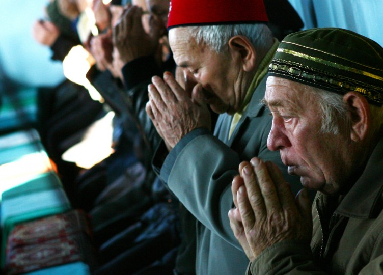 Belarusian muslims pray in the mosque on the first day of the Eid al-Adha (Kurban Bayram) in the village of Ivye some 125 km outside Minsk, on October 4, 2014. Muslims worldwide commemorate the Feast of the Sacrifice, marking the end of the Hajj pilgrimage to Mecca in Saudi Arabia and commemorating Abraham's willingness to sacrifice his son Ismail on God's command. (Sergei Gapon/Getty Images)