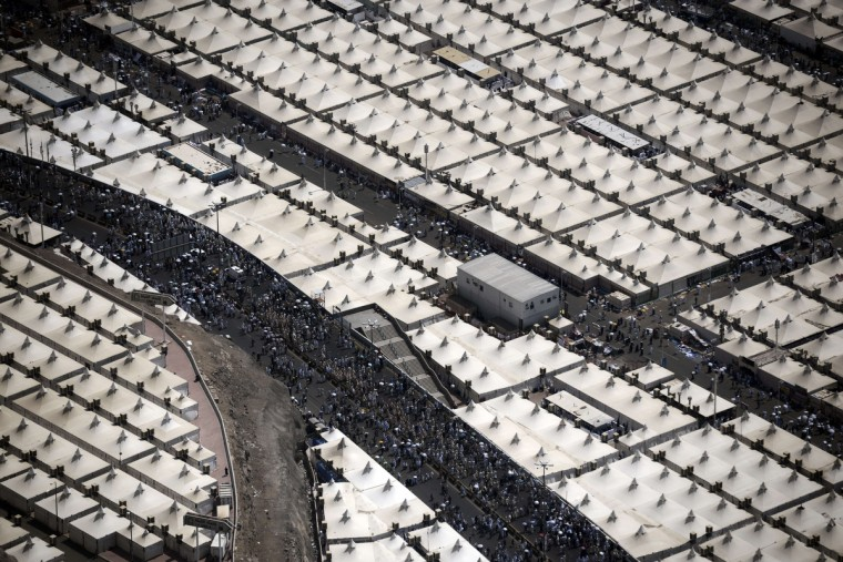 An aerial view shows tens of thousands of tents hosting piligrms in Mina near the holy city of Mecca, on October 5, 2014. Pilgrims pelt pillars symbolizing the devil with pebbles to show their defiance on the third day of the hajj as Muslims worldwide mark the Eid al-Adha or the Feast of the Sacrifice, marking the end of the hajj pilgrimage to Mecca and commemorating Abraham's willingness to sacrifice his son Ismail on God's command in the holy city of Mecca. (Mohammed Al-Shaikh/Getty Images)