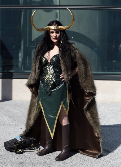 A fan in costume poses on arrival for the opening session of the 2014 New York Comic Con at the Jacob Javits Center on October 9, 2014. The four day event which runs October 9-12 is the largest pop culture event on the East Coast. Timothy A. Clary/AFP/Getty Images