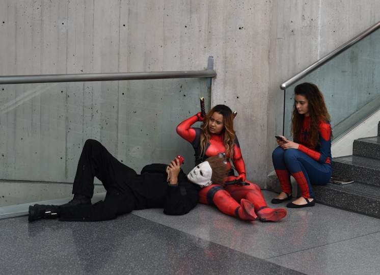 Fans in costume pose on arrival for the opening session of the 2014 New York Comic Con at the Jacob Javits Center. Timothy A. Clary/AFP/Getty Images