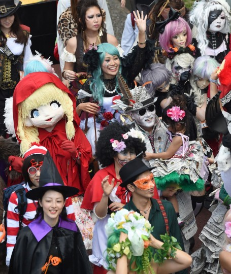People dressed in costumes take part in the Halloween Parade in Kawasaki, suburb of Tokyo, on October 26, 2014. More than 100,000 visitors watched the street costume parade in which some 2,500 people took part. (Toru Yamanaka/Getty Images)