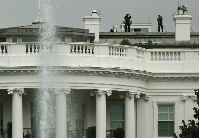 Members of the US Secret Service stand watch on the roof of White House September 30, 2014 in Washington, DC. White House intruder Omar Gonzalez, the man arrested last week after jumping the White House fence, went deeper into the building than what was previously reported. (Mark Wilson/Getty Images)